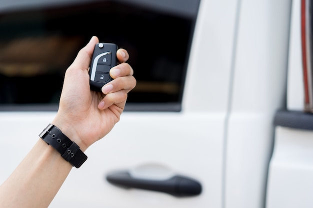 Driver man hand holding keyless of autonomous car for unlock via wireless technology Premium Photo