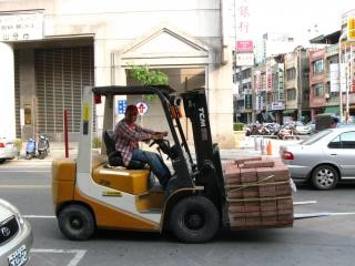 Driving a Forklift Free Photo