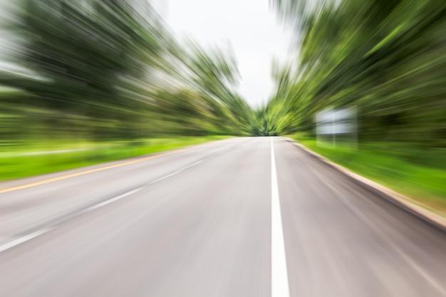 driving high speed in asphalt road, motion blur effect Premium Photo