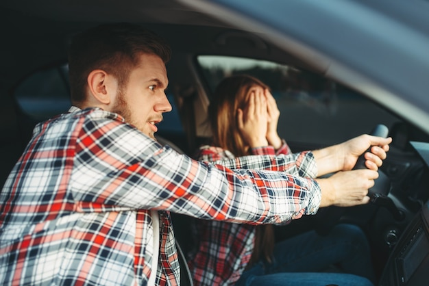 Driving instructor helps driver to avoid accident Premium Photo