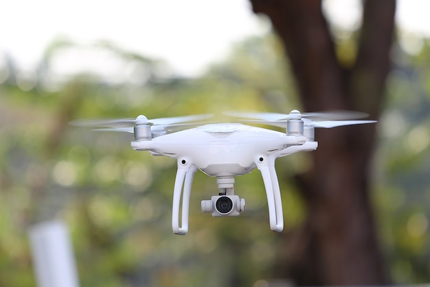 Drone flying in the air at the park Premium Photo