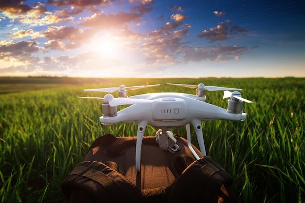 Drone quad copter on green corn field Premium Photo