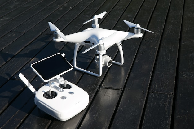 Drone quad copter with high resolution digital camera and its remote control pad Premium Photo