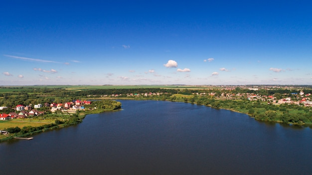 Drone with a camera, beautiful summer small river from a height Premium Photo