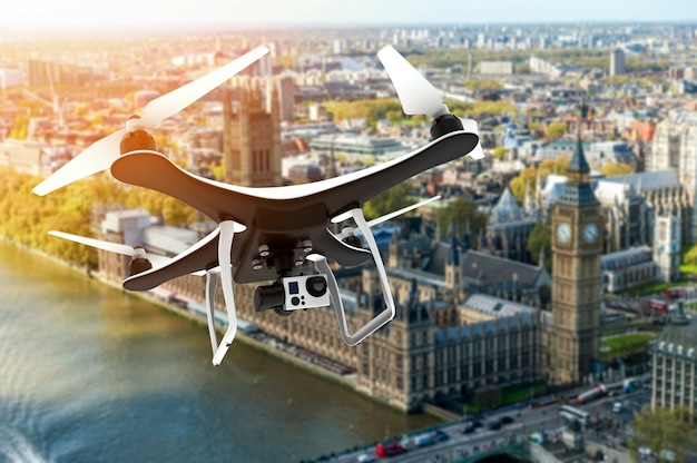 Drone with digital camera flying over london Premium Photo