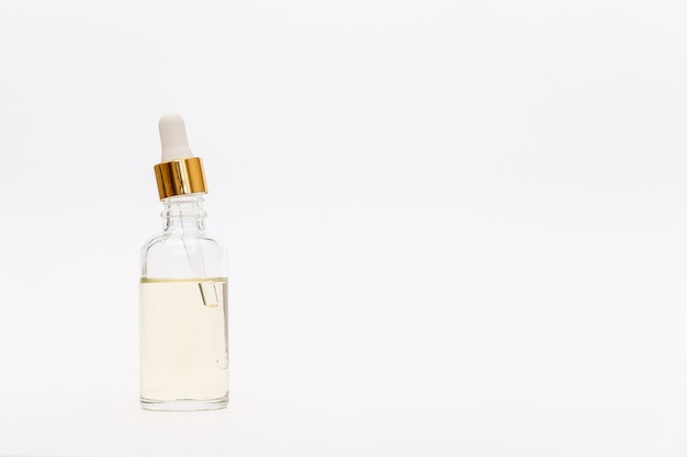 Dropper glass bottle mock-up. ð¡osmetic pipette on white background. Premium Photo