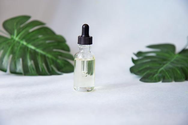 Dropper glass bottle with pipette Premium Photo