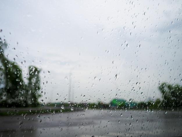 Drops of rain on blue glass Premium Photo