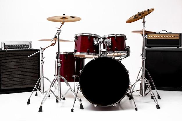 Drum set on white set of musical instruments Premium Photo