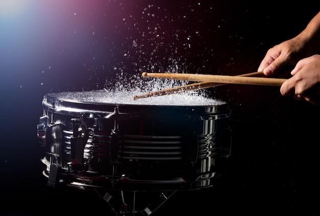 The drum sticks are hitting Premium Photo