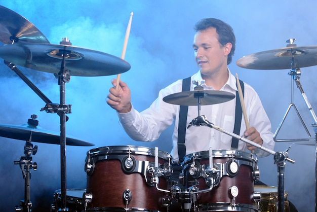 Drummer man to play the drums Premium Photo