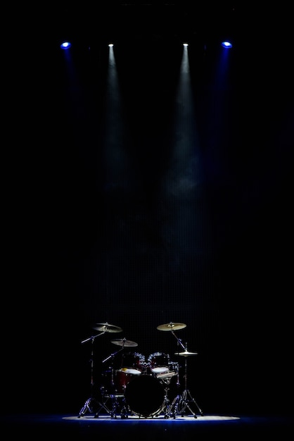 Drummer playing the drums on stage Premium Photo