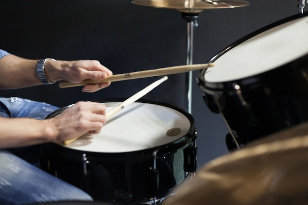 Drummer with drumsticks Free Photo