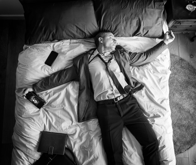 Drunk business man falling asleep as soon as he came back home Free Photo