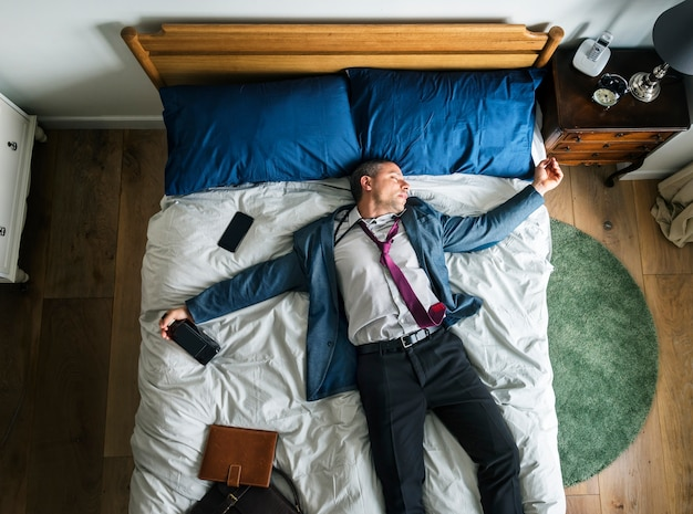 Drunk business man falling asleep as soon as he came back home Premium Photo