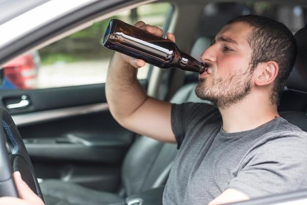 Drunk man sitting inside car Free Photo