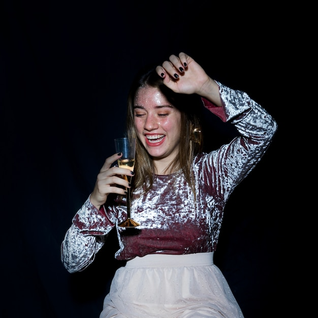 Drunk woman standing with champagne glass Free Photo