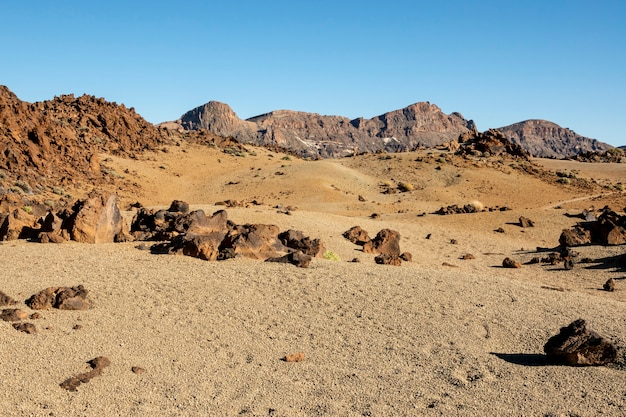 Dry desert relief with clear sky Free Photo