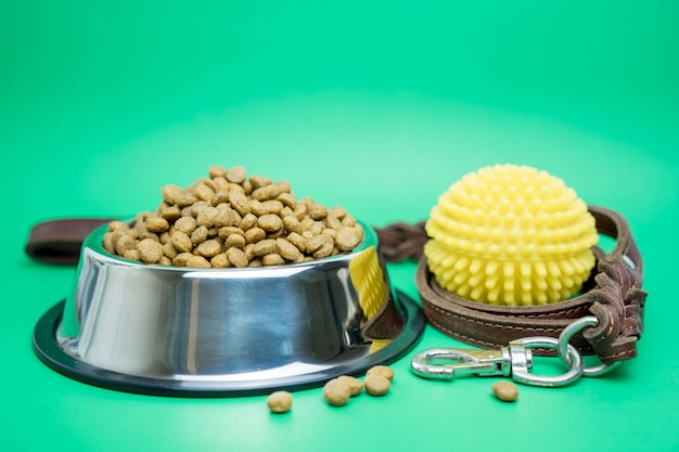 Dry food and pet supplies for dog or cat concept Premium Photo