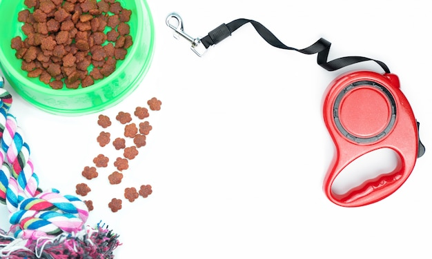 Dry food with pet accessories on white background Premium Photo