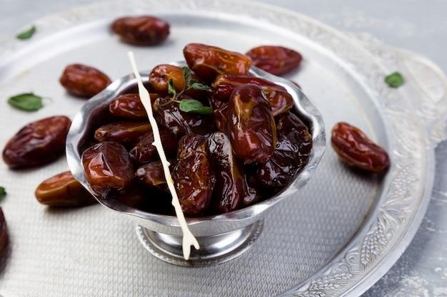 Dry fruit dates on silver tray, Premium Photo