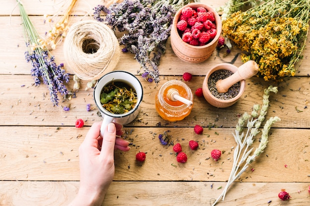 Dry medicinal herbs, tea and raspberries Premium Photo
