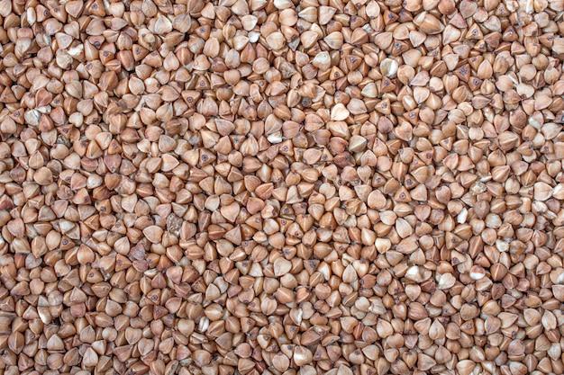 乾燥そばソバ。健康的な食事。穀物テクスチャ背景 Premium写真