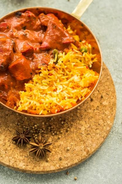 Dry spices near rice dish Free Photo