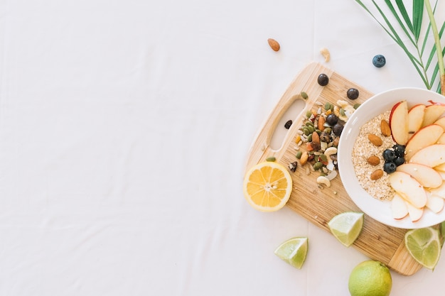 Dryfruits and oatmeal snack on white background Free Photo