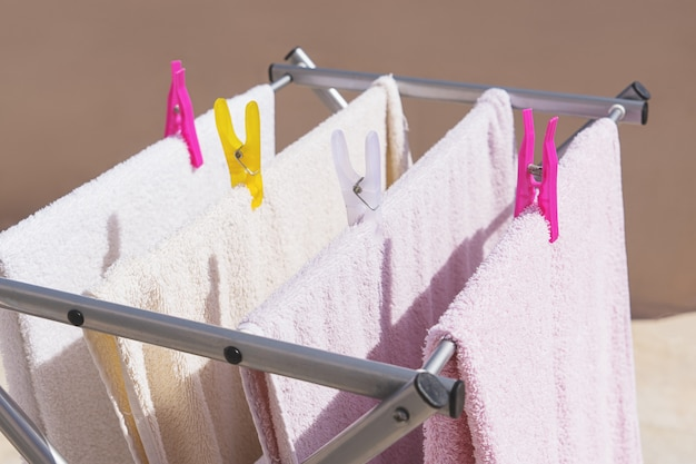 Drying clean clothes after washing Premium Photo