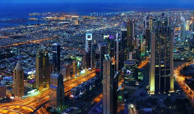 Dubai cityscape at night, view from burj khalifa's 124th floor Premium Photo