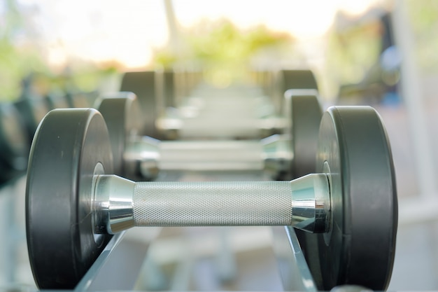 Dumbbell in gym. Premium Photo