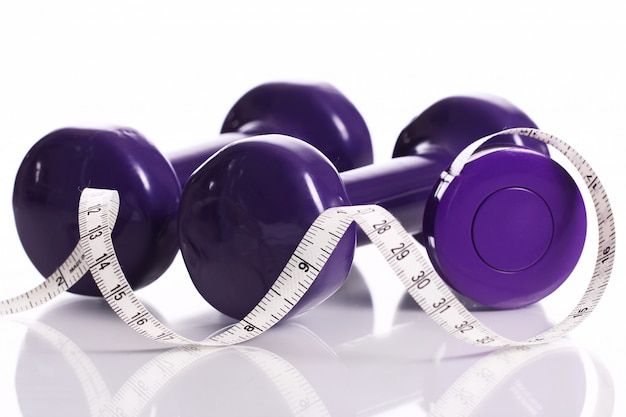 Dumbells and measure tape Free Photo