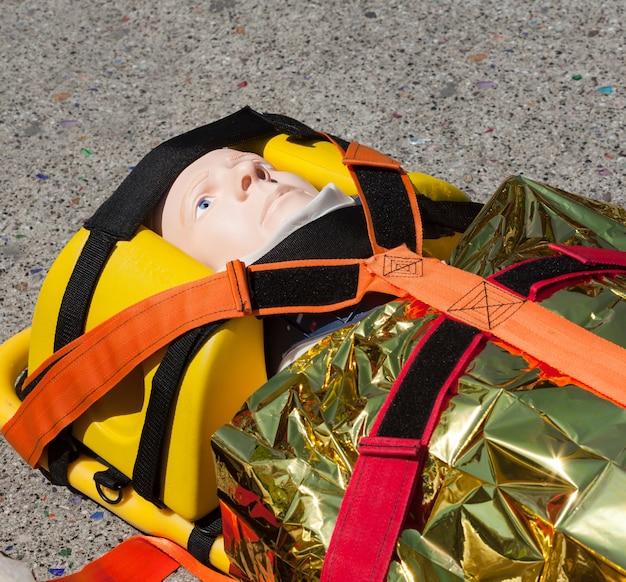 Dummy immobilized on a stretcher Premium Photo