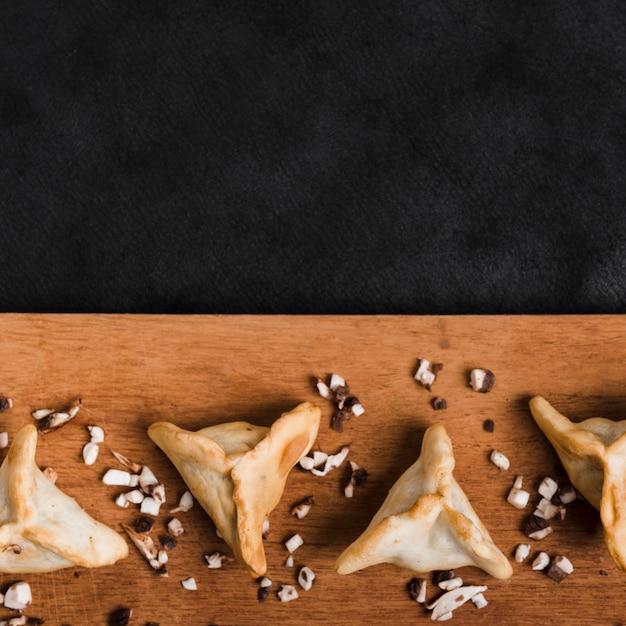 Dumplings on wooden desk against black backdrop Free Photo