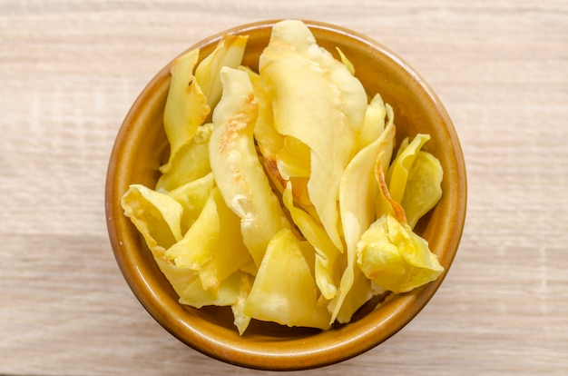 Durian chips fried snack fruit in brown blow on wooden background Premium Photo