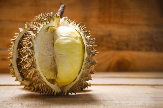 Durian riped fresh durian peel tropical fruit on wooden background on summer Premium Photo
