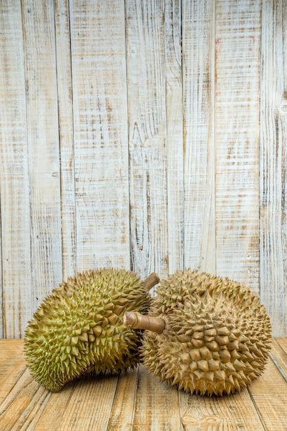 Durian on wood background,king of fruits Premium Photo