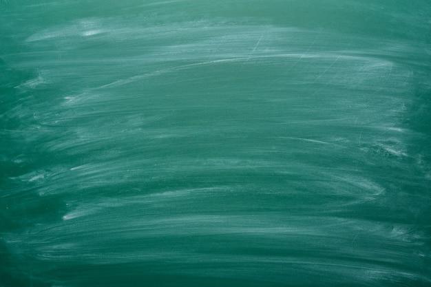 Dusty green chalk black board background Premium Photo