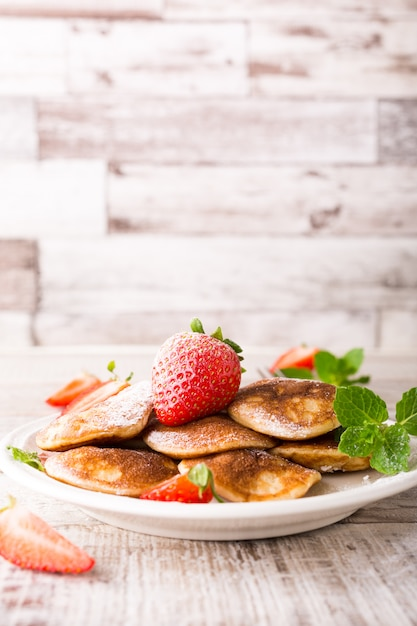 Dutch mini pancakes called poffertjes Premium Photo