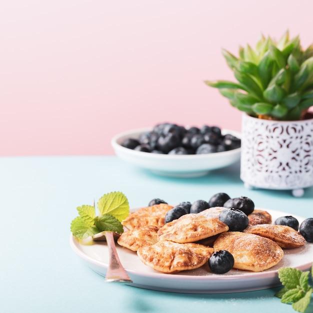 Dutch mini pancakes Premium Photo