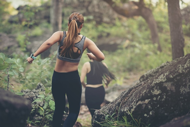 Dynamic running uphill on trail female athlete runner top view Premium Photo