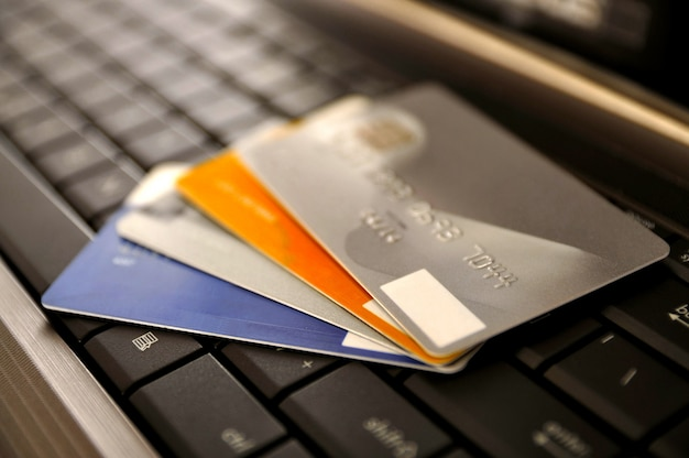 E-commerce concept. group of credit cards and laptop with shallow dof Premium Photo