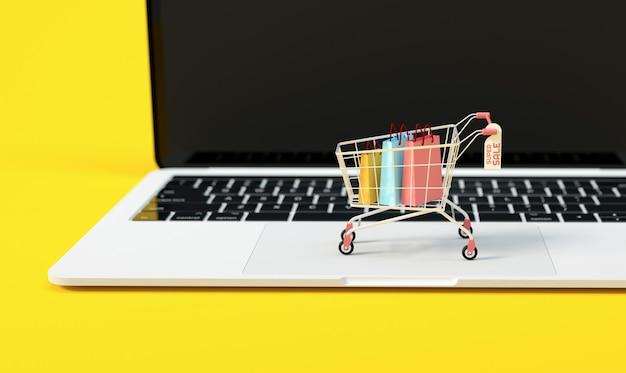 オンラインショッピングの概念、eコマースビジネスおよびマーケティングの背景のためのラップトップコンピューターの上にトロリー Premium写真