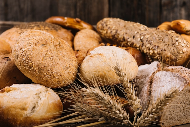 Ear of wheat in front of baked bread Free Photo