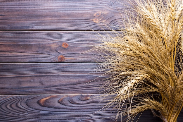 Ears of wheat on old wooden table Premium Photo
