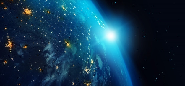 Earth from space at night with city lights and blue sunrise on stars background. Premium Photo