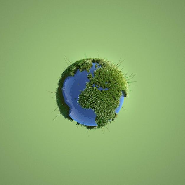 Earth miniature on green background Premium Photo