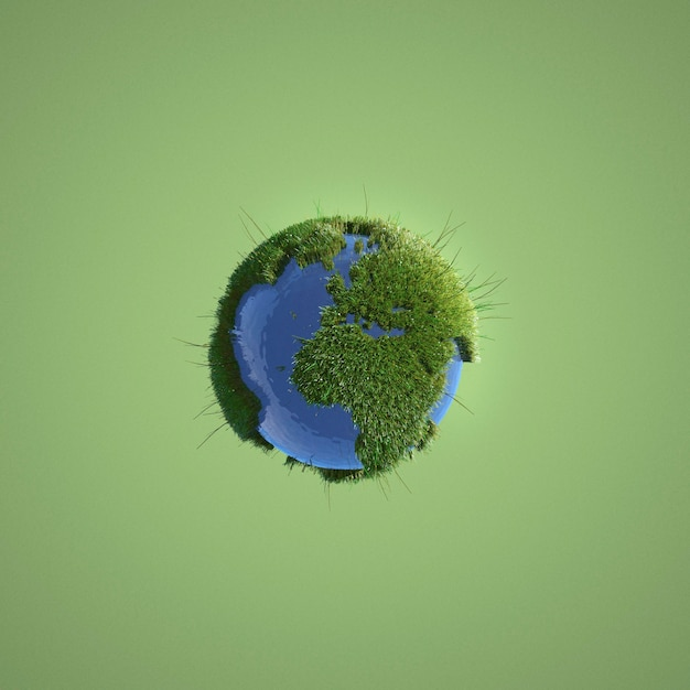 Земля миниатюра на зеленом фоне Premium Фотографии