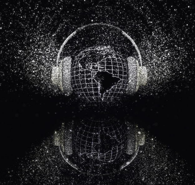 Earth with headphones with glittery effect on black background Free Photo